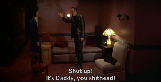 "Dennis Hopper, raising his arm angrily, replies, ""Shut up! It's Daddy, you shithead!"""