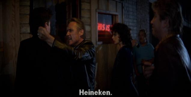 """Outside on a dark street, MacLachlan has just told Hopper he drinks Heineken. Hopper answers crossly, """"Heineken."""""""